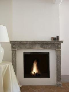 bedroom fire place at villa il santo