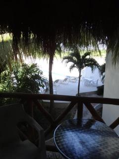 view from bedroom balcony overlooking pool