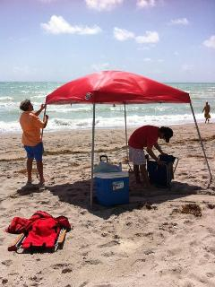 Provided: 1 red beach tent + 4 beach chairs + 4 beach towels