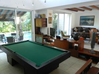 Private 4 bedroom home in a lush tropical garden.