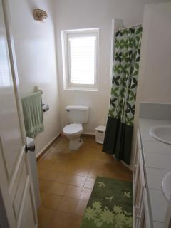 Guest bathroom with hot shower and his and hers sinks