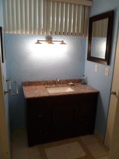 Spacious sink area located between the 2nd bedroom and bathroom