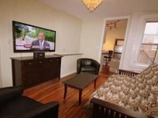 Living Room with 54' Flat Screen & DVD Player!