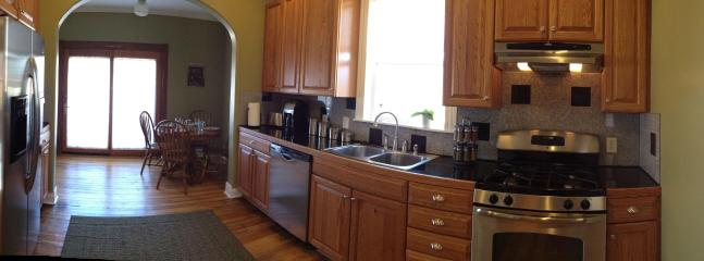 Gourmet kitchen with stainless appliances and granite countertops and backsplash.