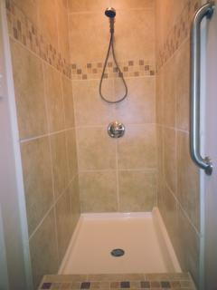 Beautiful tile shower in attached bath