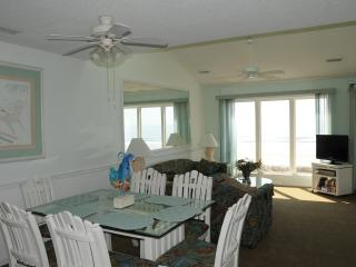 Dining area looking toward living room. Check the large window which is direct view of ocean.