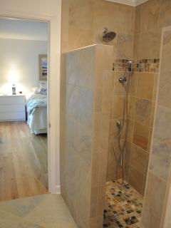 The master bathroom features a walk-in custom shower