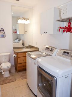 A nice laundry room with a large capacity Smart LG Washer and Dryer