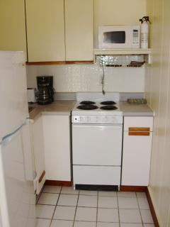 full mini kitchen with stove, oven, microwave, refrigerator