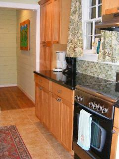 Kitchen with Stainless Steel Appliances & Granite Counter Tops