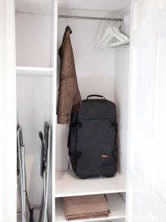 Wide and spacious clothes closet.