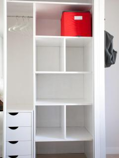 WIDE WARDROBE IN LIVING ROOM.
