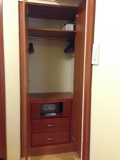 Closet with hangers, drawers, iron w/ ironing board and a digital safe/mini-vault for your valuables