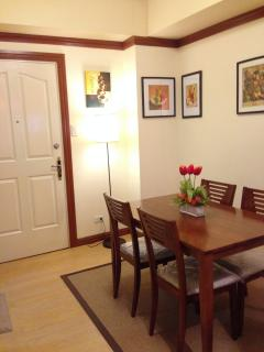 Dining area showing the main door of the unit
