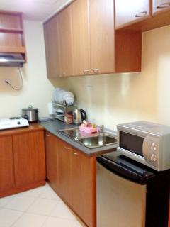 With refrigerator, microwave, rice cooker, electric kettle, cookware, diningware & kitchen utensils.