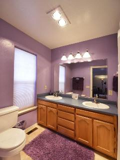 Master Bedroom connected bathroom in purple decor and extra long 6 ft tub/shower
