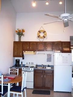 Fully equipped kitchen with table setting for 4