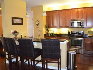 Fully equipped kitchen w/ marble counter tops and stainless steel appliances