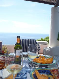 you just need white wine, parma ham and melon; the view is provided