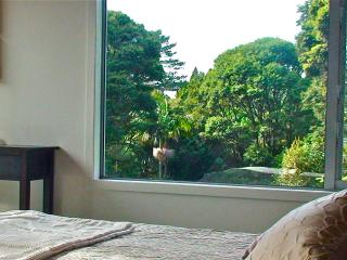 King size bed with views across the garden.