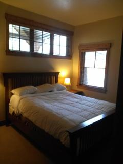 First floor guest bedroom with queen bed