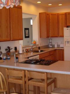 Kitchen - sink overlooks view through Great Room