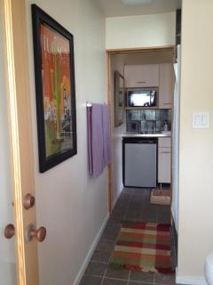 From bath looking into kitchen, pocket door separates the two