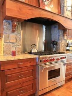 Kitchen with granite counter tops, 6 burner Wolf stove and SubZero refrigerator