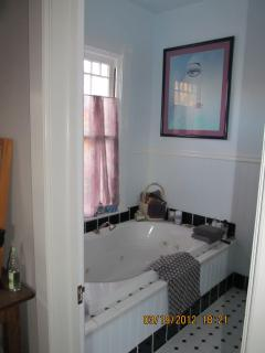 View into the Dora Powell Suite's bathroom; includes jetted tub with hand shower.