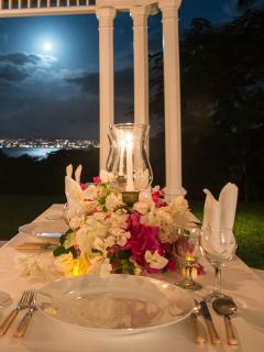 But everyone shows up on the verandah for candlelight dinners served by longtime butler Reuben Riley ... and the...