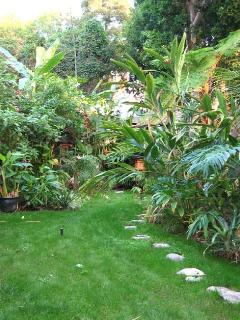 One third garden. Beat your way through the brush to see a village gazebo, a pond, a vege garden +++
