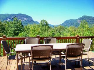 Spacious deck with mountain views and outdoor gas grill.