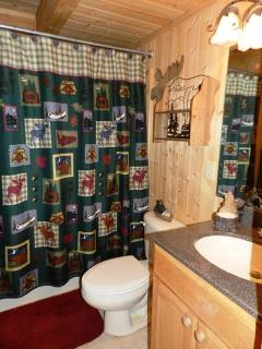 Full bath on main floor with tub/shower combination.