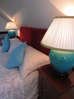 Gorgeous matching bedside lamps and antiquefurniture