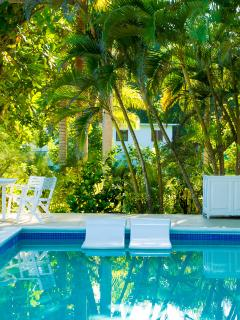 Partially masked by foliage, only its beachfront cottage is visible from the Serenity pool deck.  Privacy is not...