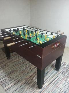Foosball table in basement.  Tornado foosball table - built for champs!