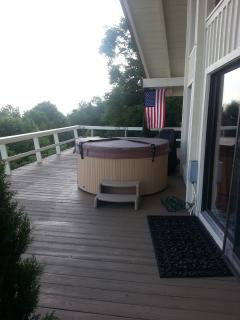 Deck showing hot tub