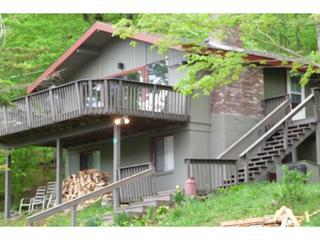 Front of house with large deck and lake views
