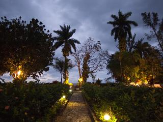 An old cut stone walkway leads through the lush garden to the beach, just a few yards from the villa.