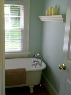 Pretty spa bathroom with antique clawfoot tub