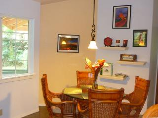 Hale Lezarde Dining Area with Garden view and 'Pele Corner' with Volcano Art