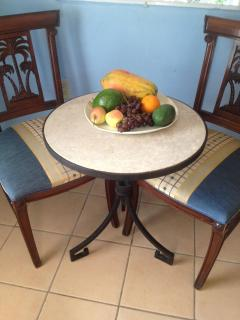 Breakfast table with bounty of local fruits