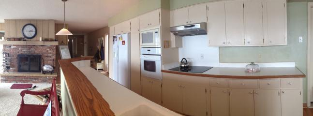 Galley kitchen-different angle. Living room .