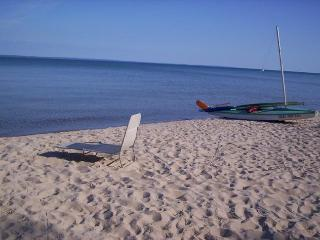 Bring your small sailboat or kayak and launch it from the beach. The beach is never crowded.