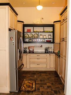 Kitchen has a wet bar as well as a wine freg.