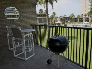 From the Balcony overlooking the pool area. BBQ or eat out every night, You're On Vacation!