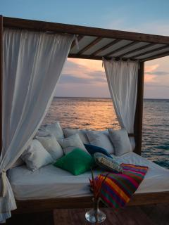 Daybed on the deck of master bedroom