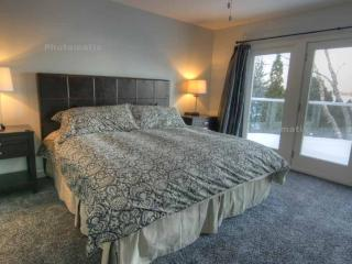 Master bedroom with private bath and lakeview