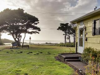 Ocean view cottage w/ deck, yard & firepit - walk to the beach, dogs welcome!