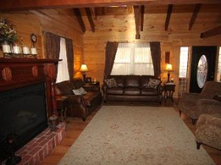 The great room - leather sofas, comfy recliners and large gas fireplace